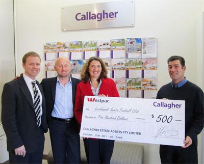 Jane Latimer with $500 cheque photo